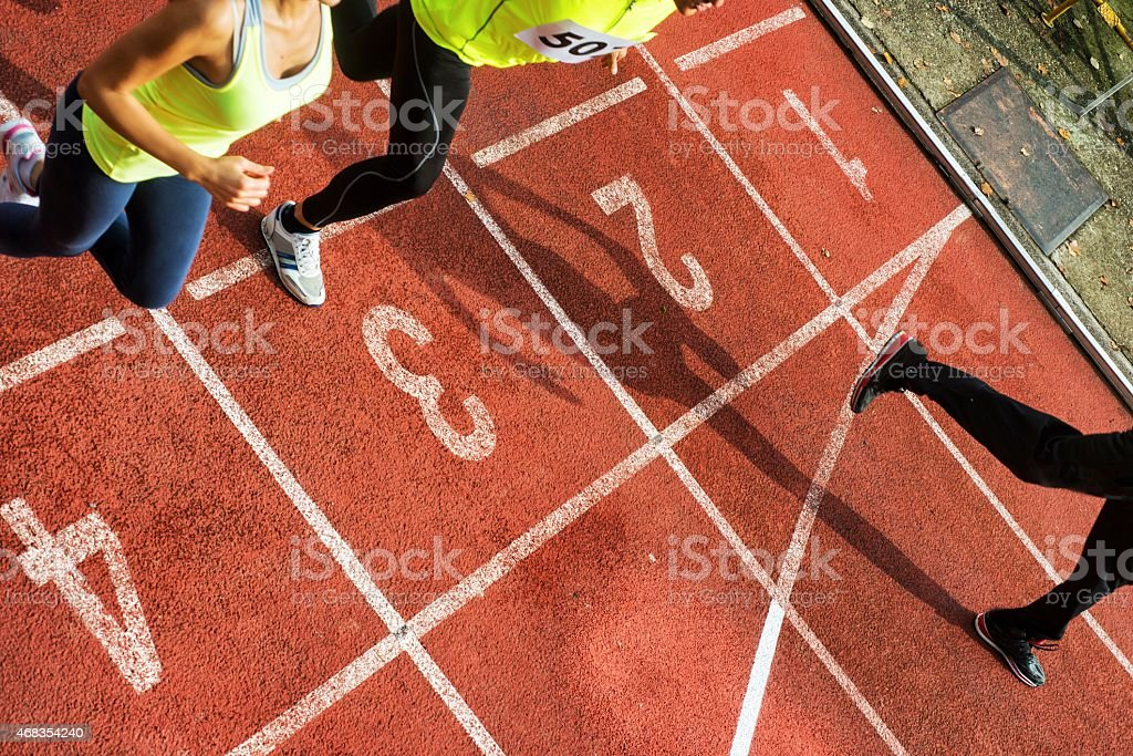 Group of Athlets Crossing the Finish Line royalty-free stock photo