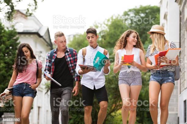 Group of attractive teenage students walking to university picture id849331550?b=1&k=6&m=849331550&s=612x612&h=74suoount6lapfh pdp2z1gzpgmw 5cbjpjuhlbopvi=