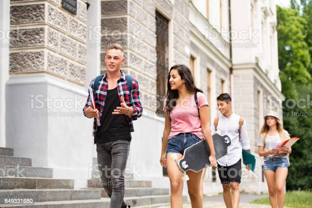 Group of attractive teenage students walking to university picture id849331680?b=1&k=6&m=849331680&s=612x612&h=ng1 ed4jvwlnvlbxte7lp4kvsq21ln6tdxmqwe1tlzi=