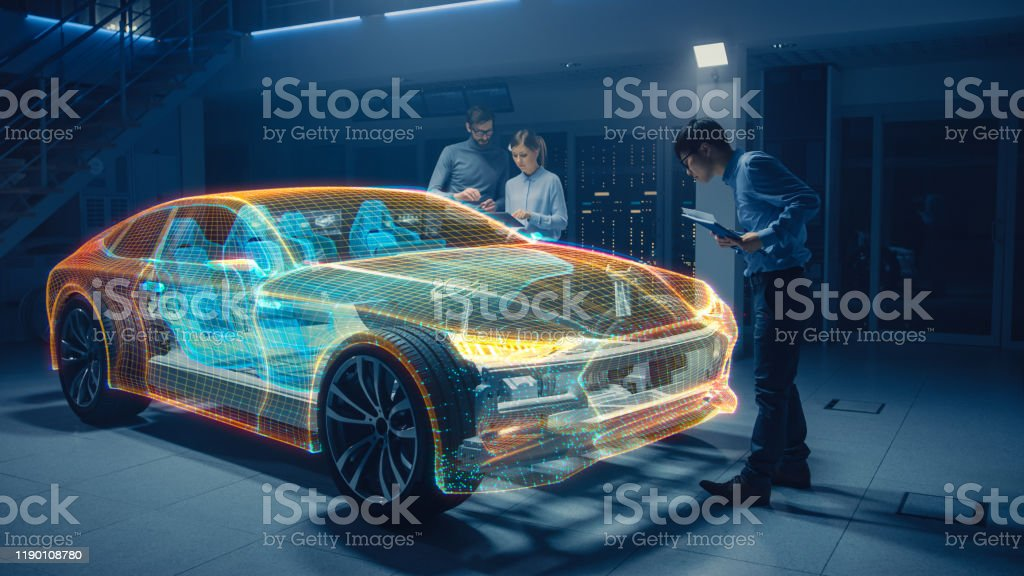 Group of Automobile Design Engineers Working in Virtual Reality 3D Model Prototype of Electric Car Chassis. Automotive Innovation Facility: 3D Concept Vehicle Generated with 3D CAD Software. Group of Automobile Design Engineers Working in Virtual Reality 3D Model Prototype of Electric Car Chassis. Automotive Innovation Facility: 3D Concept Vehicle Generated with 3D CAD Software. Adult Stock Photo