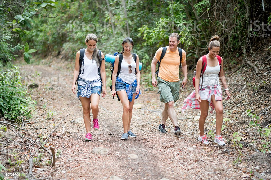 Group of backpackers hiking stock photo