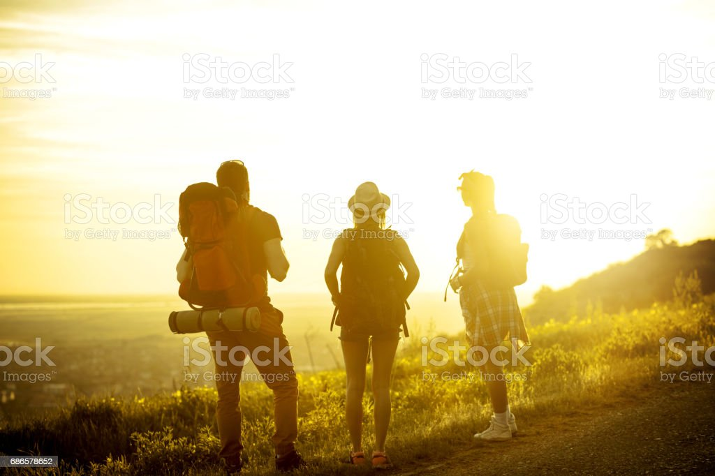 Group of backpackers hiking royalty-free stock photo