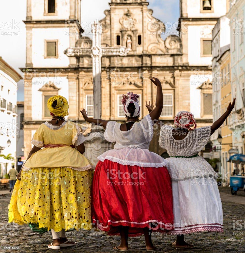 Group of 'Baianas' in the famous Pelourinho in Salvador, Bahia, Brazil stock photo