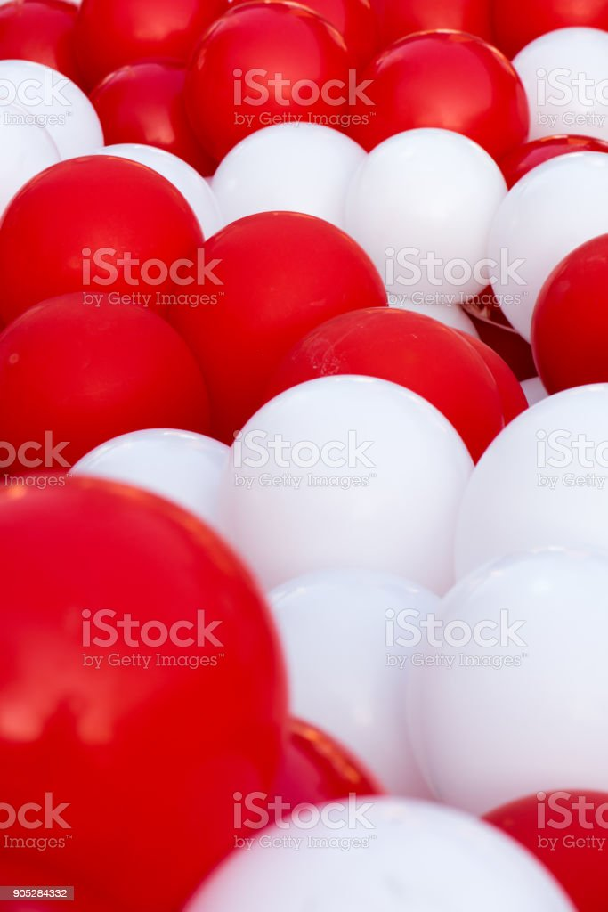 Group of balloons in various shades of red and white stock photo