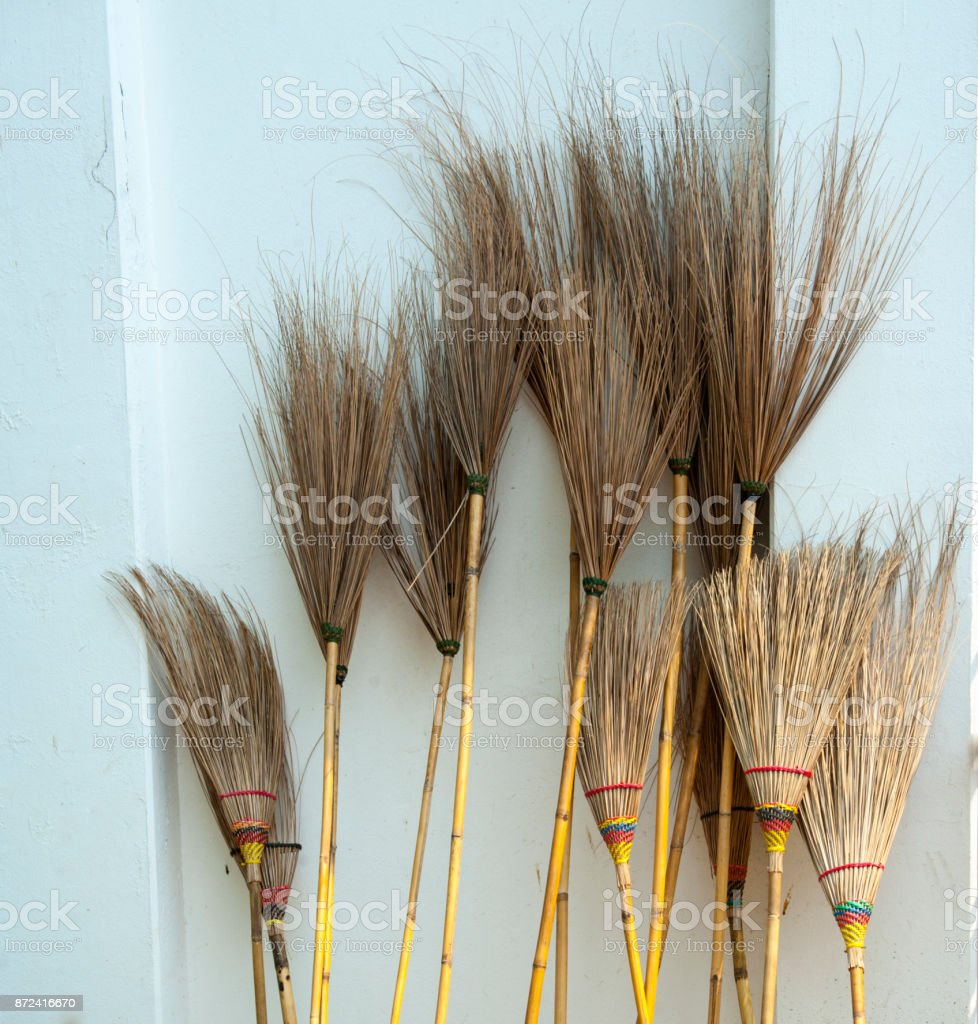 Group of bamboo broom stock photo