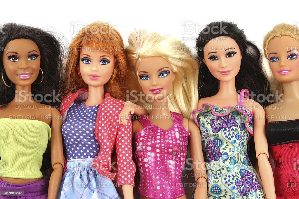Group Of Barbie Doll Friends Posed On White Background Stock Photo ...