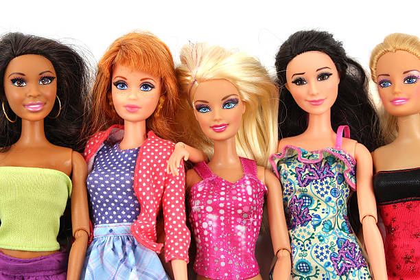 Group of Barbie Doll friends posed on white background stock photo