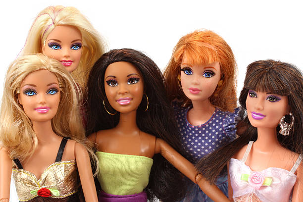 Group of Barbie dolls posed together stock photo