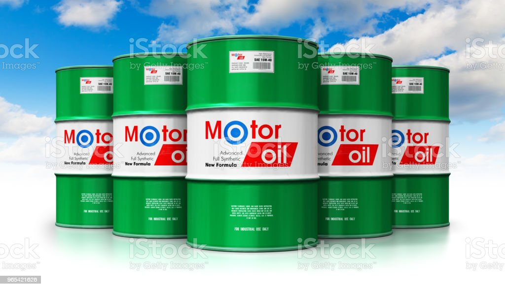 Group of barrels with motor oil lubricant against blue sky royalty-free stock photo