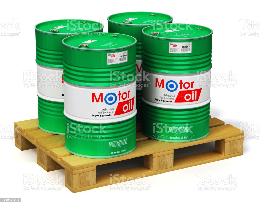 Group of barrels with motor oil lubricant on shipping pallet isolated on white royalty-free stock photo