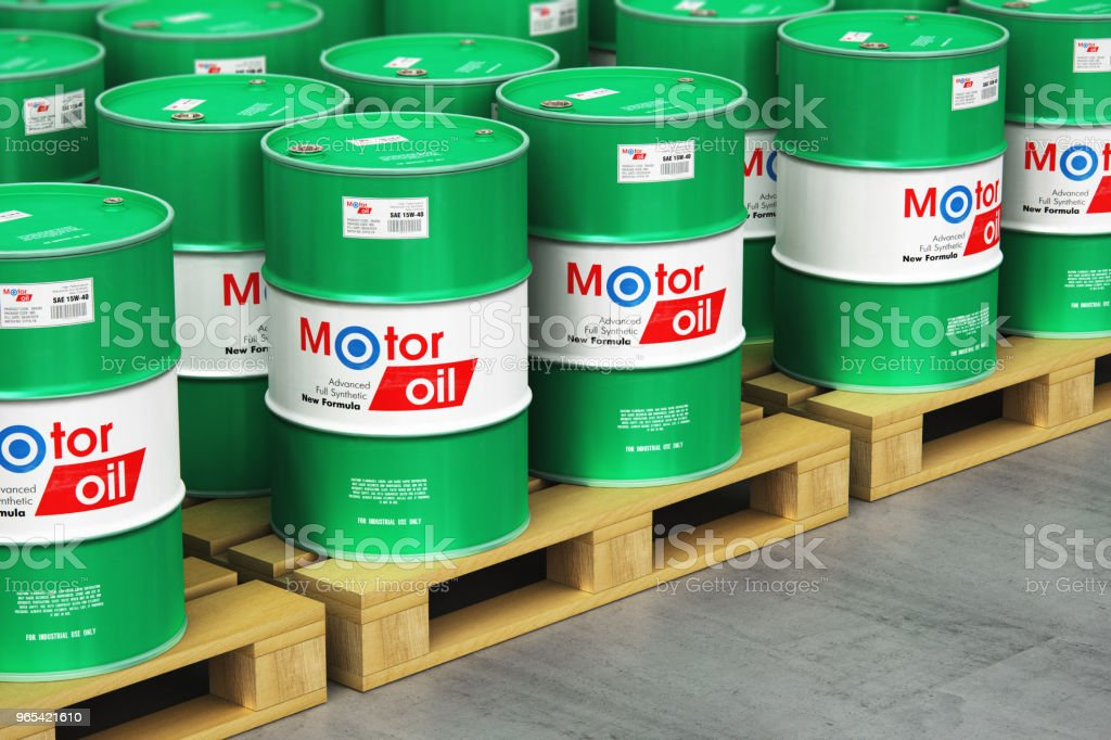 Group of barrels with motor oil lubricant on shipping pallets in warehouse royalty-free stock photo