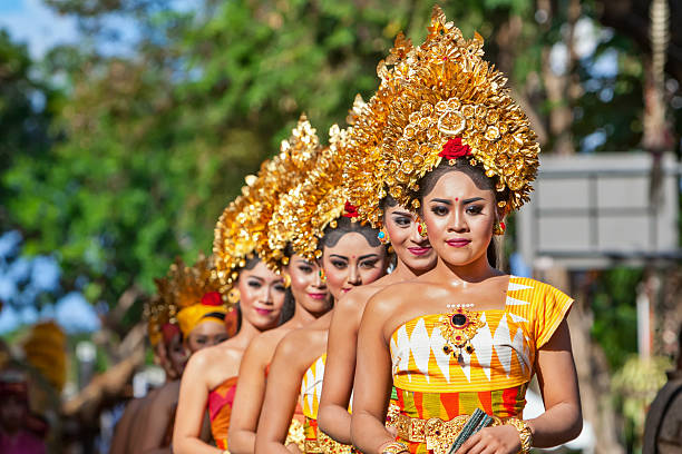 Group of beautiful Balinese women dancers in traditional costumes stock photo
