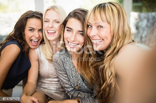 istock Group of beautiful women having fun 674767172