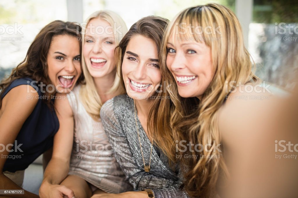 Group of beautiful women having fun stock photo