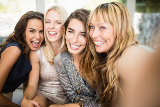 Group of beautiful women having fun Portrait of beautiful women having fun at party 30 34 years stock pictures, royalty-free photos & images