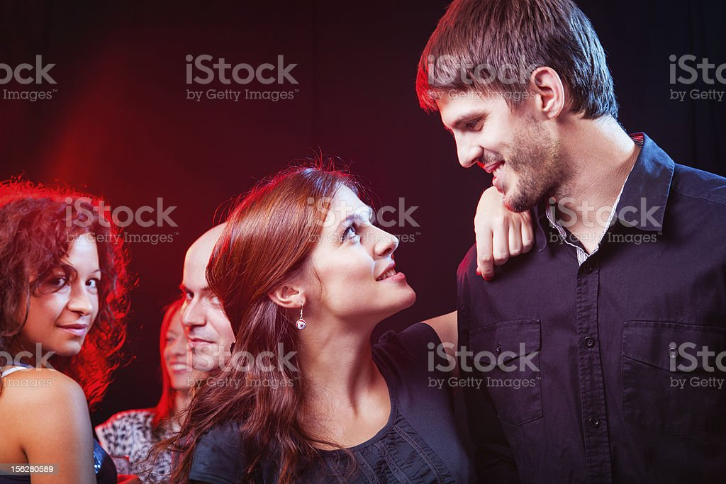 Group of beautiful young friends at the nightclub. royalty-free stock photo