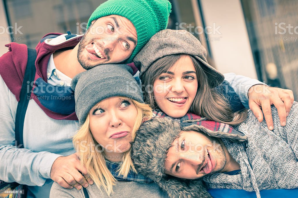 Group of best friends taking selfie outdoors with funny faces stock photo