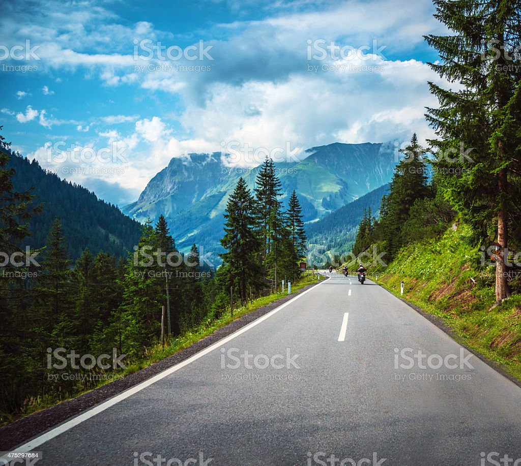 Group of bikers in mountains stock photo