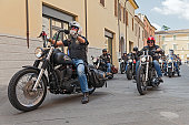 Lugo (RA) Italy - September 22, 2013: a group of bikers riding american motorbikes Harley Davidson at motorcycle rally 'Sangiovese tour' by Ravenna Chapter