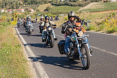 Riolo Terme (RA) Italy - September 22, 2013: a group of bikers riding american motorbikes Harley Davidson at motorcycle rally \