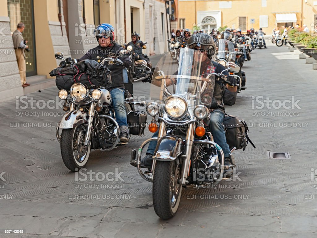 group of bikers riding Harley Davidson stock photo