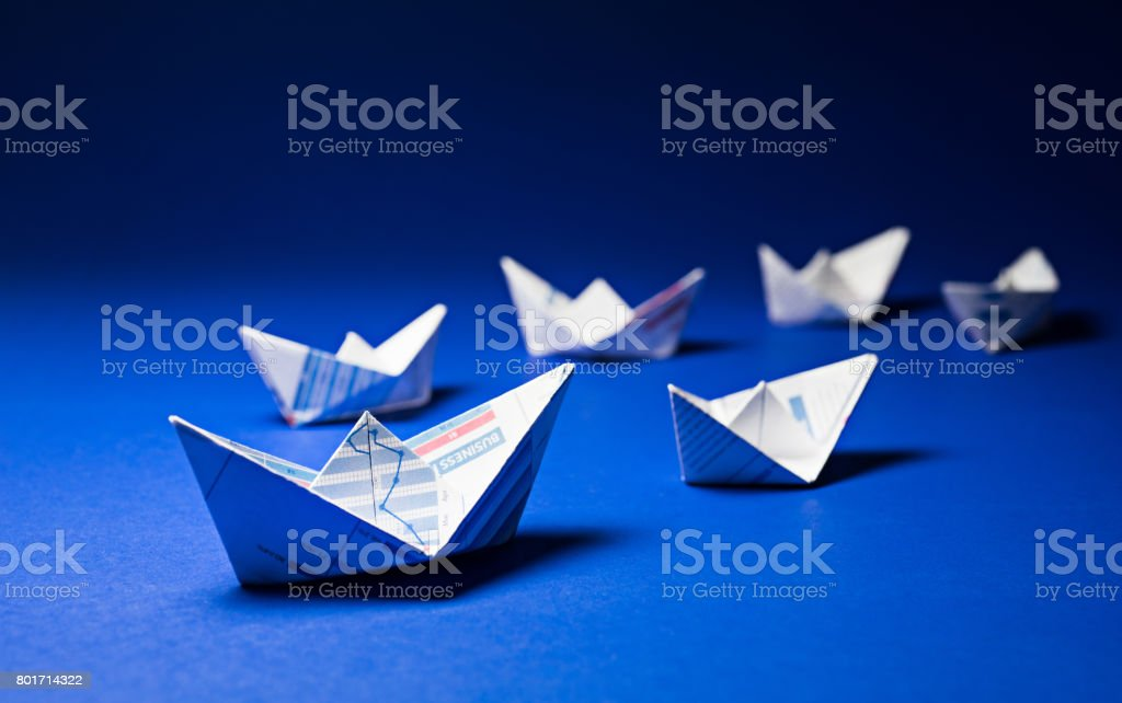 Group of boat paper graph on blue ocean.For business leader concept.