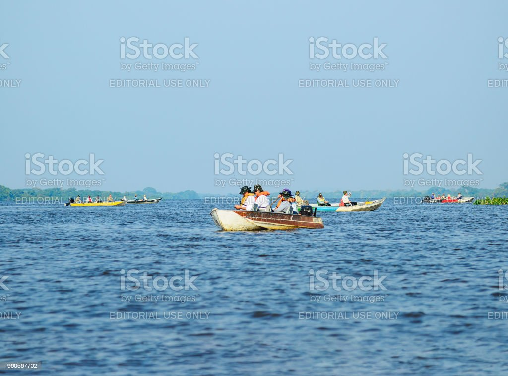 Group of boats with fishermen anchored on Pantanal for fishing. stock photo
