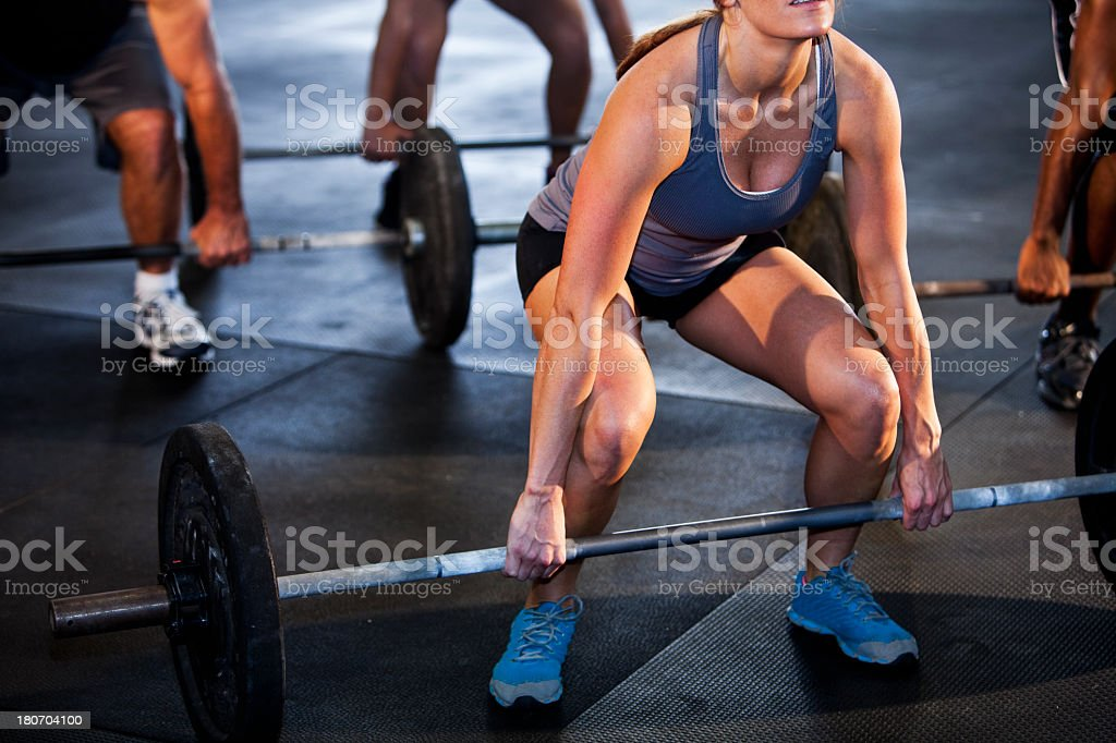Group of body builders lifting barbells stock photo
