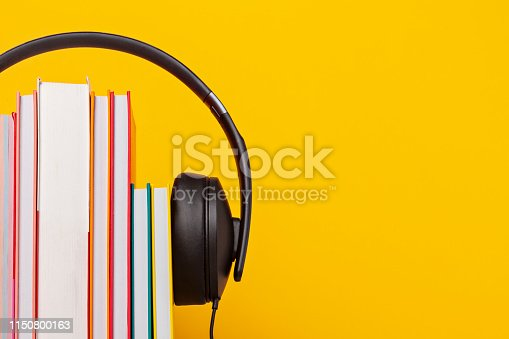 istock Group of books with the earphones. Audiobooks concept 1150800163