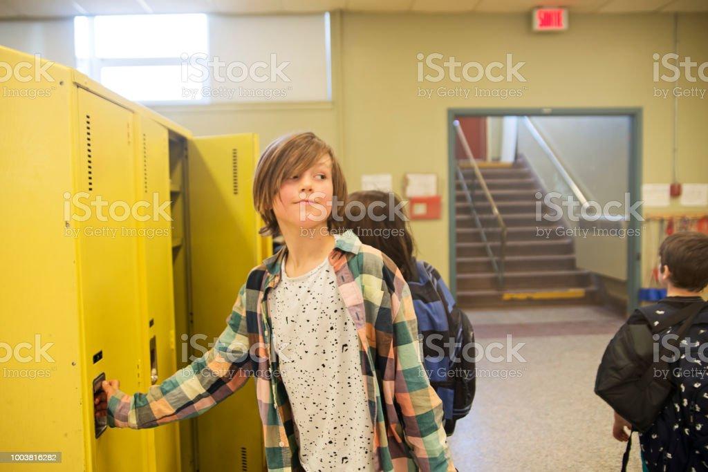 Group of boys around lockers in elementary school. stock photo
