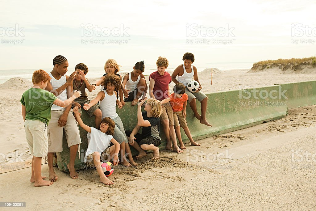 Group of boys by wall with football royalty-free stock photo