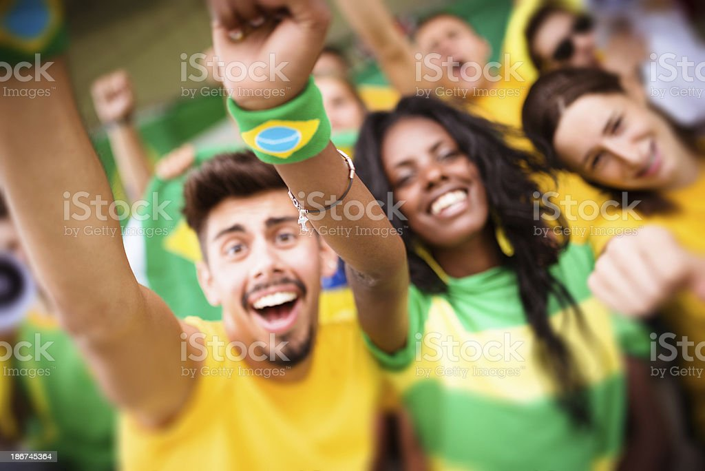 Group of brazilian supporters at stadium royalty-free stock photo