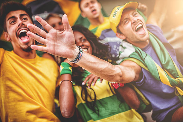 group of brazilian supporters at stadium - sports championship stock photos and pictures