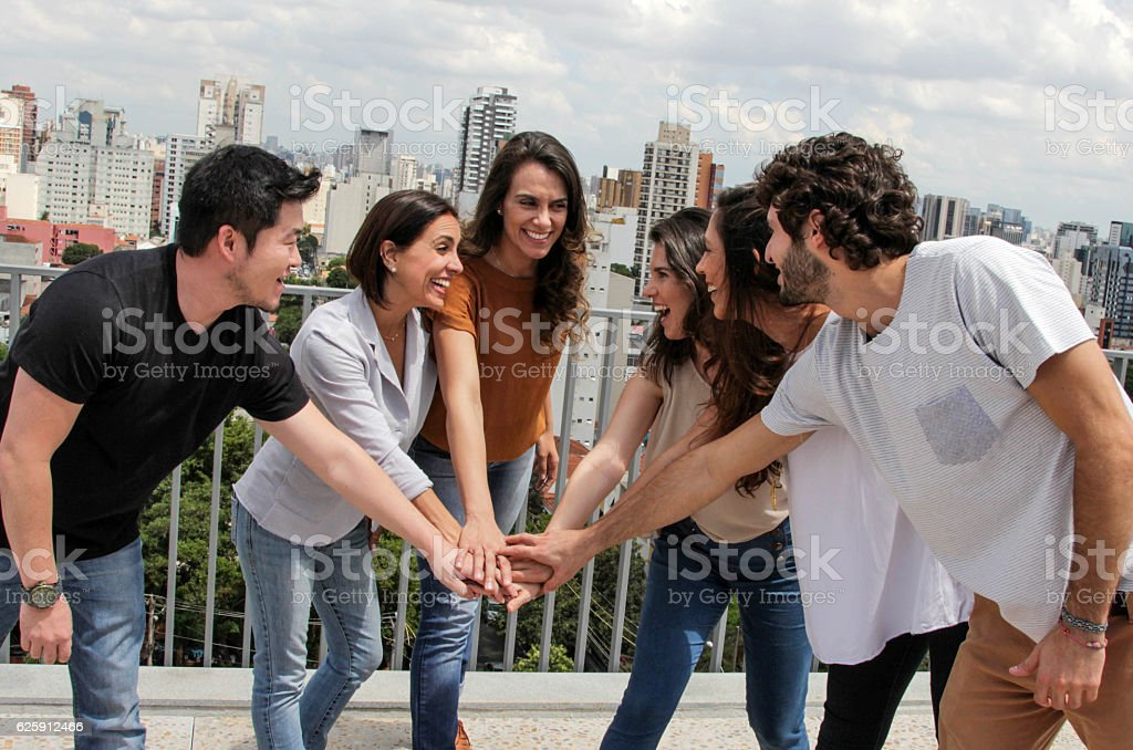 Group of brazilian young people stacking their hands - foto de acervo