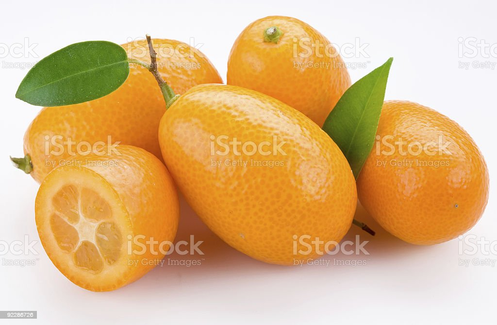 A group of bright orange kumquats with a white background stock photo