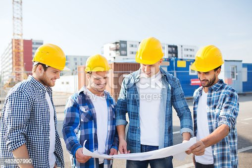 istock group of builders with tablet pc and blueprint 483807990
