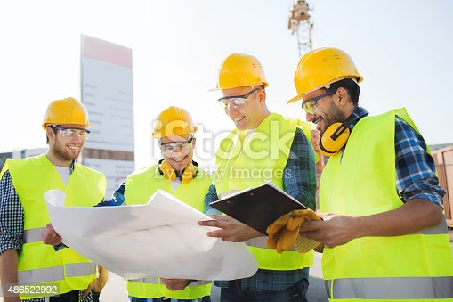 istock group of builders with tablet pc and blueprint 486522992