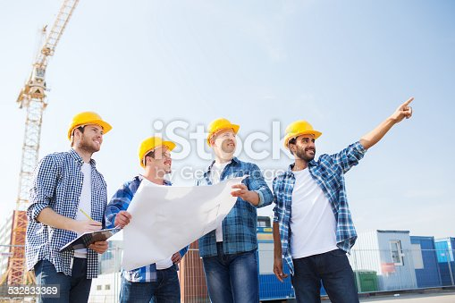 istock group of builders with tablet pc and blueprint 532833369