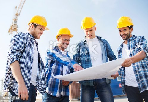 istock group of builders with tablet pc and blueprint 533649315
