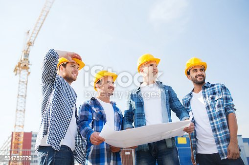 istock group of builders with tablet pc and blueprint 534757279