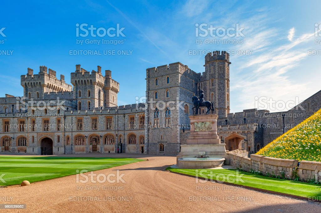 Group of buildings including Private Apartment, State Apartment, and South Wing with King Charles II Statue at The Upper Ward and The Quadrangle of Windsor Castle, a royal residence at Windsor in county of Berkshire, England, UK stock photo