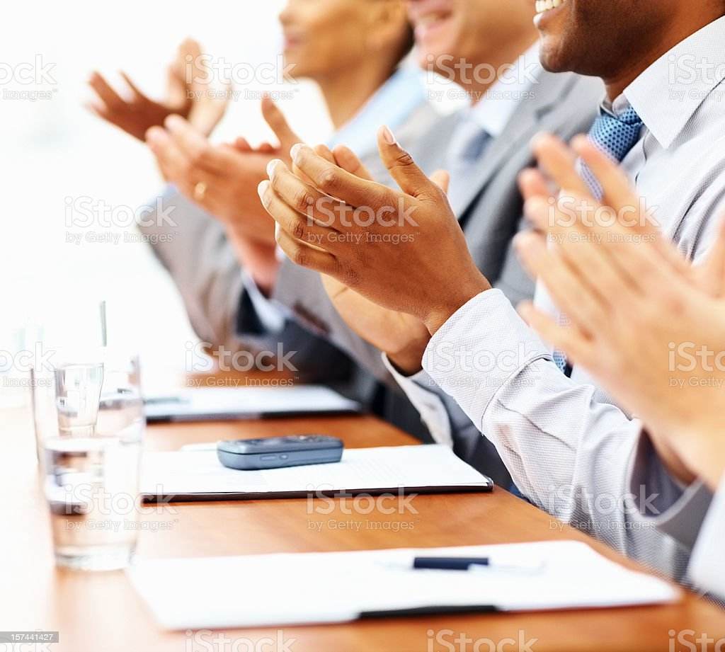Group of busines colleagues clapping hands royalty-free stock photo