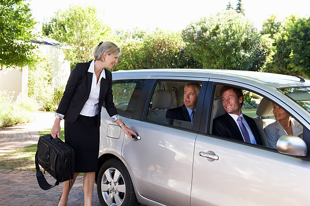 group of business colleagues car pooling journey into work - rideshare stock photos and pictures