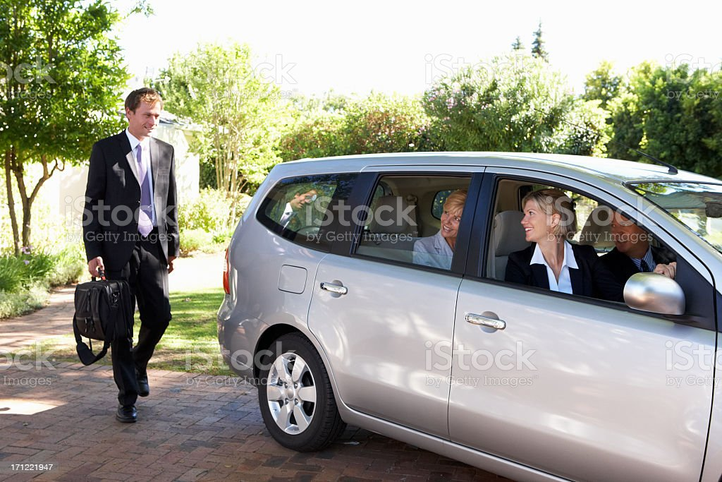 Group Of Business Colleagues Car Pooling Journey Into Work stock photo