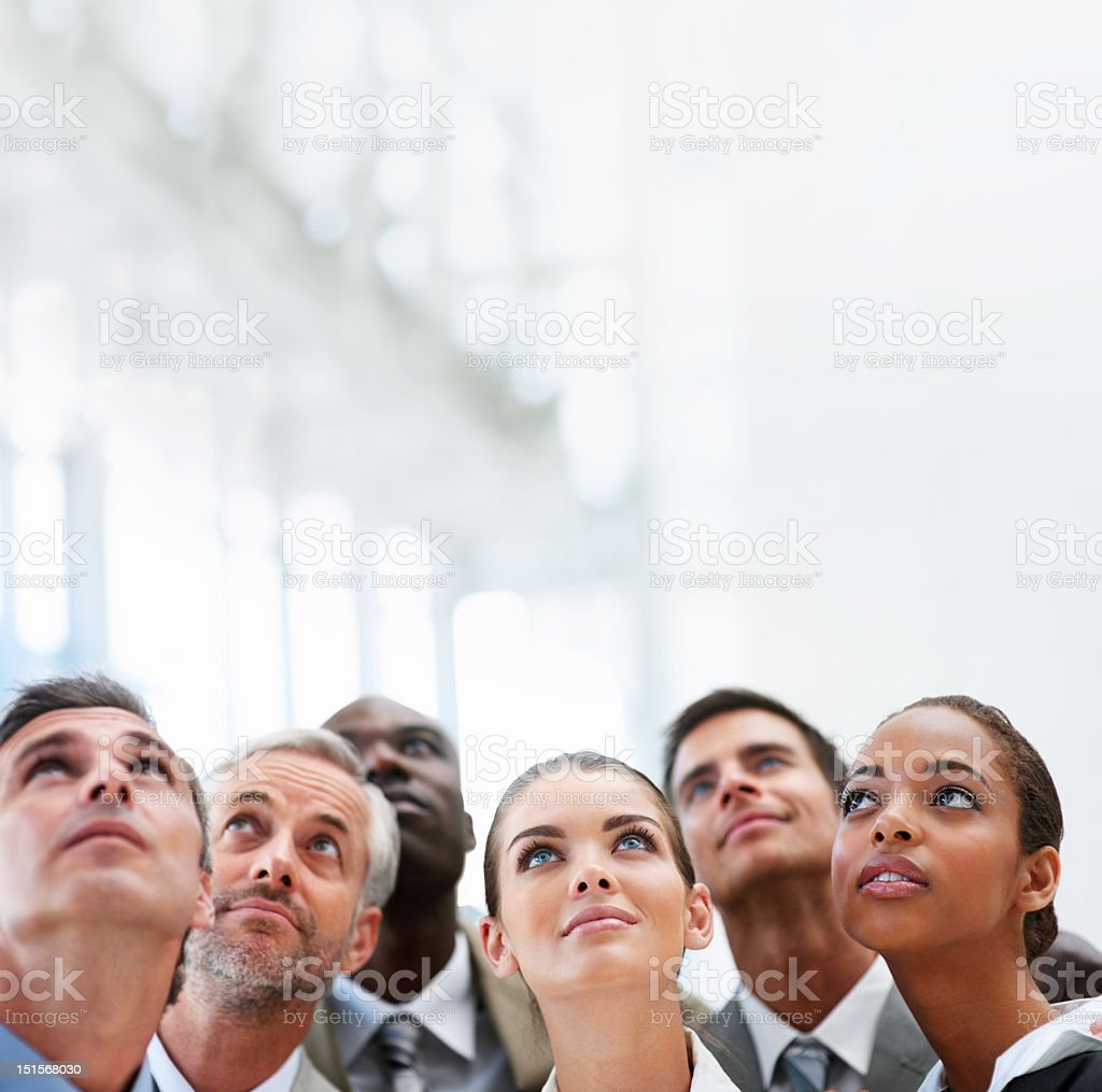 Group of business colleagues looking up royalty-free stock photo