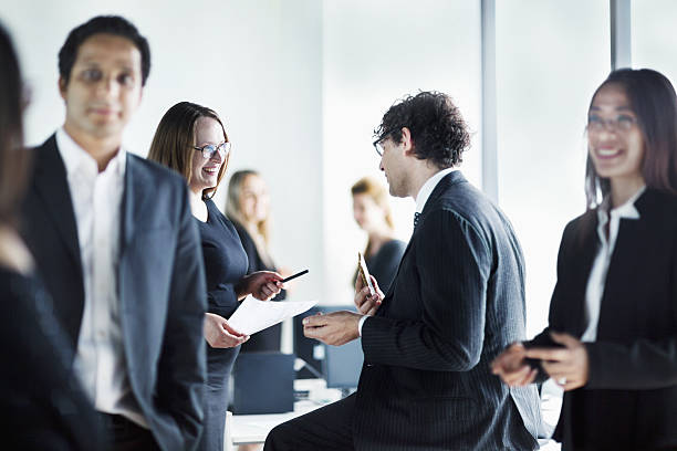 group of business colleagues talking together in office - 社内パーティ ストックフォトと画像