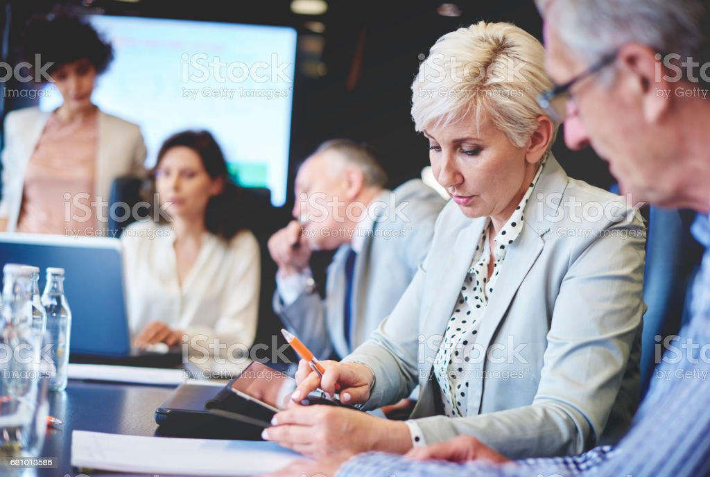 Group of business executives in meeting royalty-free stock photo