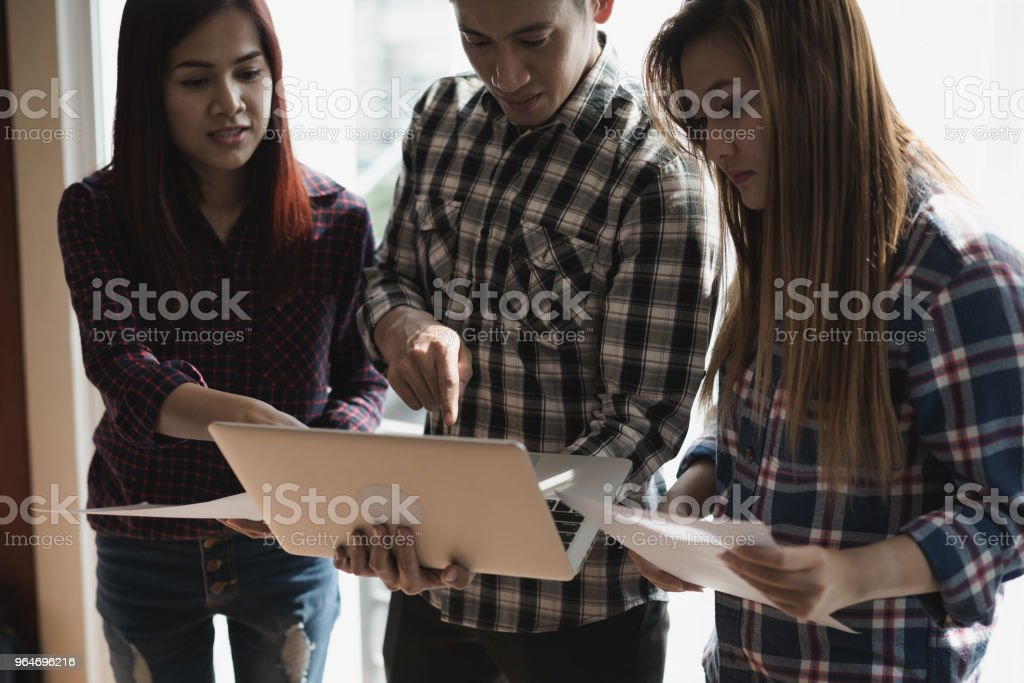 Group of Business man and Business woman working looking at laptop screen. They analyzing and brainstorming. meeting and teamwork concept. royalty-free stock photo