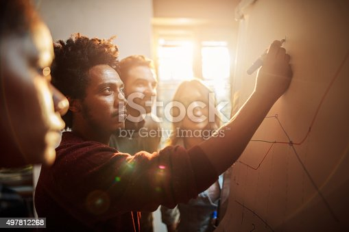 istock Group of business people analyzing a graph in the office. 497812268