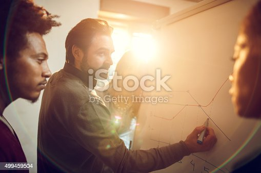 istock Group of business people analyzing a graph in the office. 499459504